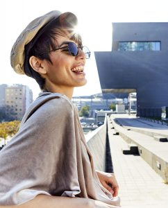 smiling portrait of Mireia in Barcelona with sunglasses