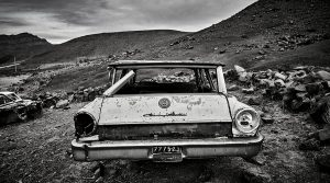 abandoned old car in the desert