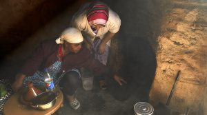 moroccan women in a organ oil smoke house
